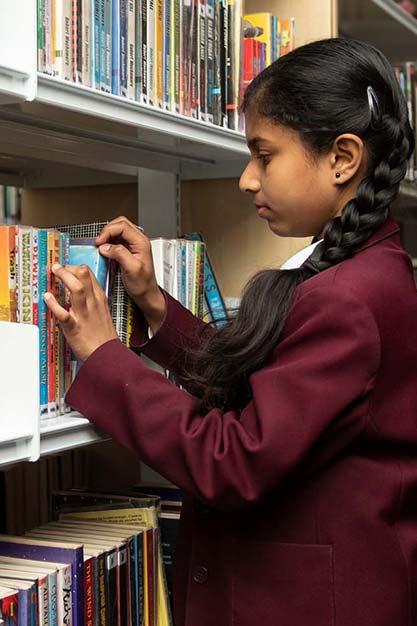 Conisborough Library Female Student Selecting Lewisham