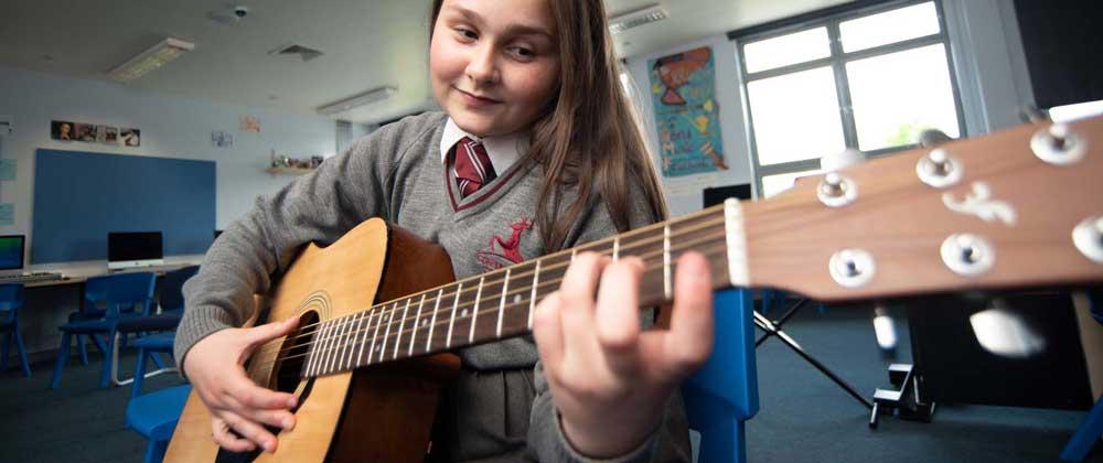 Conisborough College Music Female Student Learning Guitar Lewisham